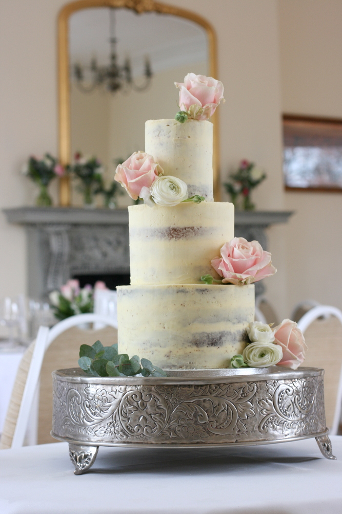 Simple elegant semi-naked buttercream wedding cake at Pembroke Lodge, Richmond Park