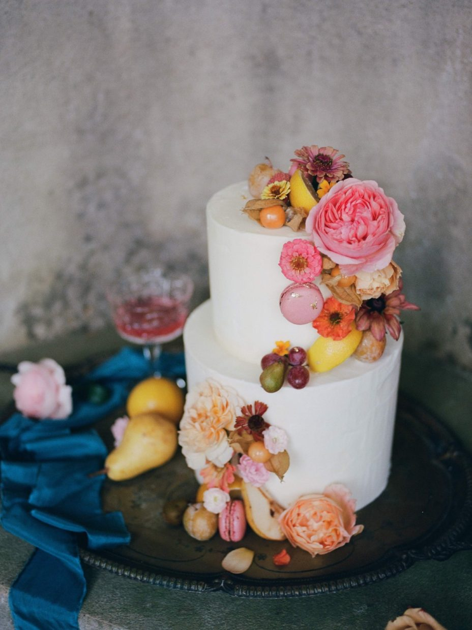 Buttercream cake for autumn wedding at Wotton House Hotel, decorated with yellow fruit and blush pink flowers