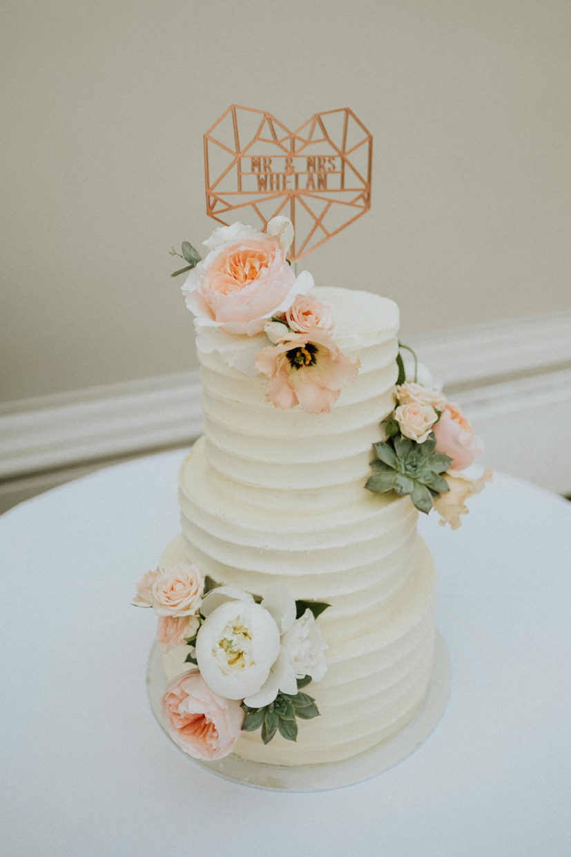Modern stylish buttercream wedding cake for Hampton Court House