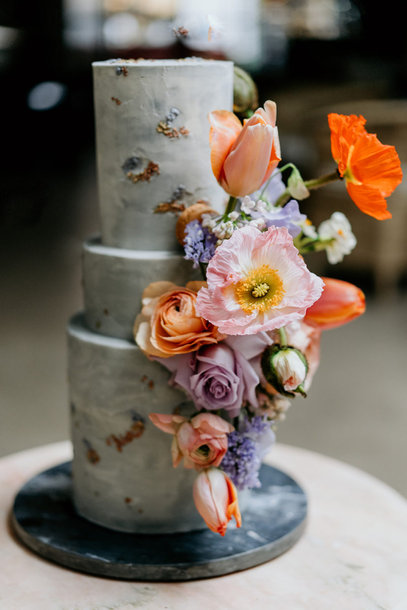 URBAN CITY TEXTURED BUTTERCREAM WEDDING CAKE WITH BRIGHT, COLOURFUL FLOWERS. FEATURED ON ROCK MY WEDDING