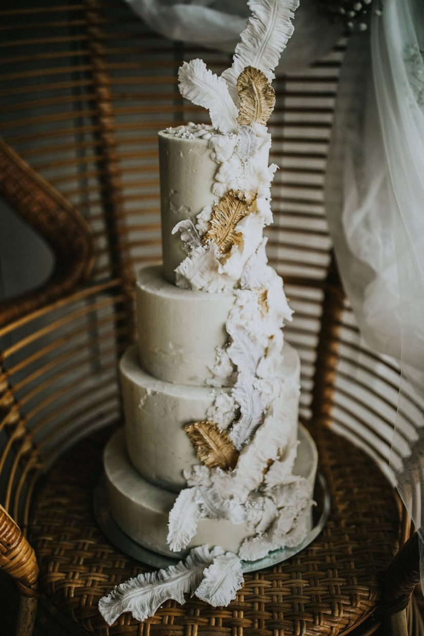 5 tier buttercream wedding cake in shades of ivory, grey and gold with handmade sugar feather details | Igor Demba