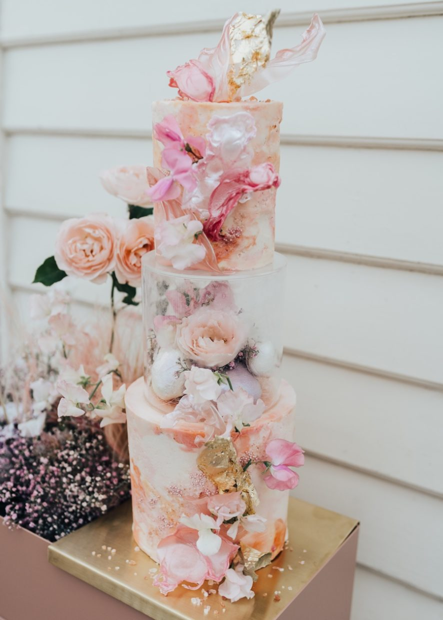 3 tier marbled buttercream cake in shades of peach, coral, pink with edible sails and gold details | Rebecca Carpenter