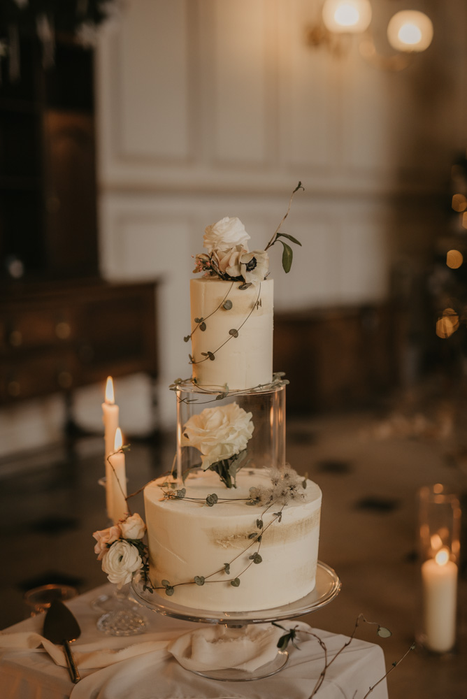Elegant buttercream cake encasing a clear tier with a white rose | Pierra G Photography