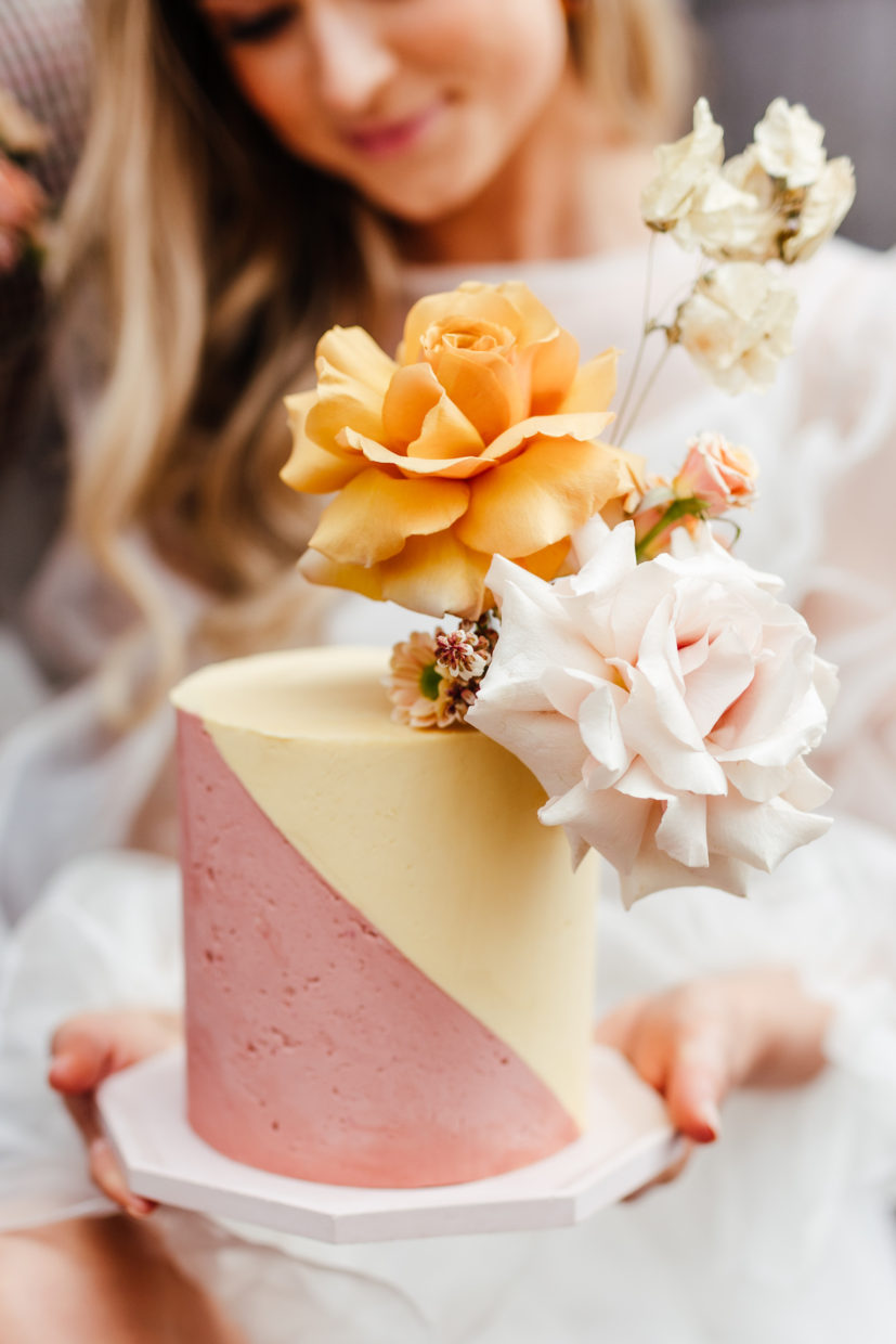 Buttercream wedding cake with diagonal pattern in pink and yellow | Kirsty Mackenzie